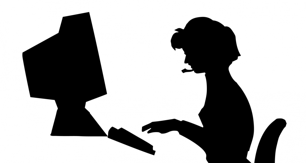 woman-typing-office-computer